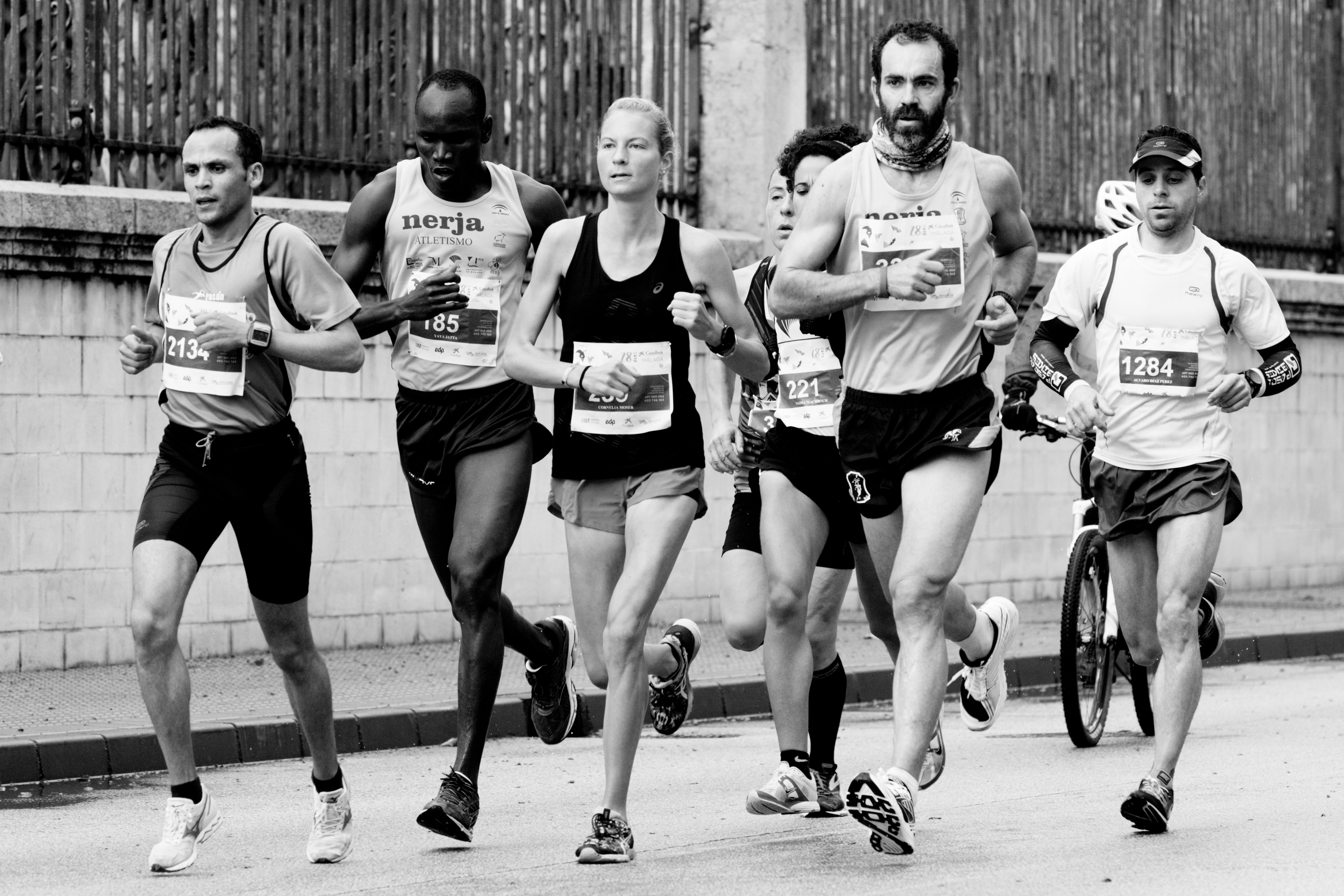 Black and white image of people running